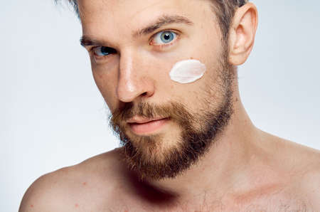 Man, cosmetic face cream. Stock Photo