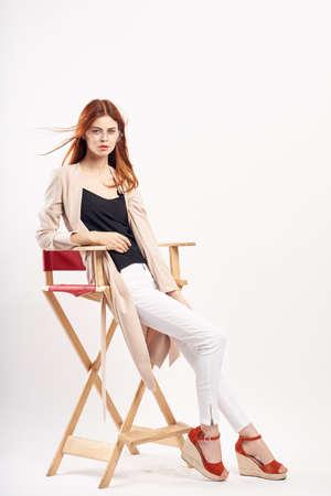 Woman on a high chair, fashion.