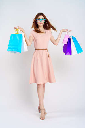 A woman with glasses keeps shopping.