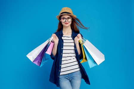 Shopaholic, shopping, glasses, woman. Фото со стока