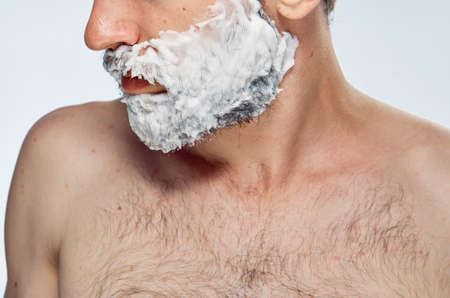 mirror image: Man in shaving foam, portrait, close-up.