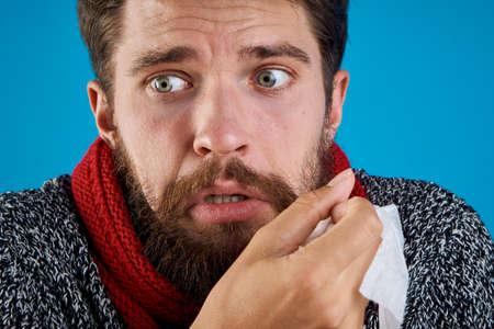 blowing nose: Sick man, portrait. Stock Photo