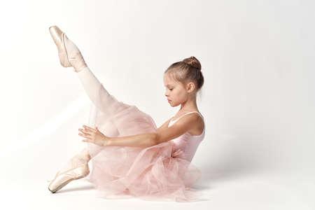 ballerina tights: child, girl ballerina on a white background.