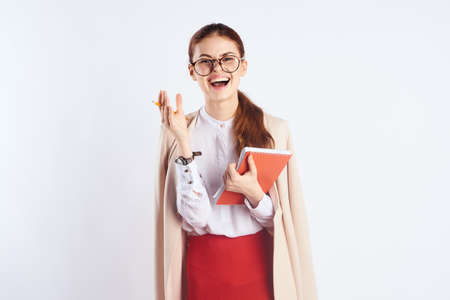 Woman in a glasses holds a notebook, notebook, smile, laughter.