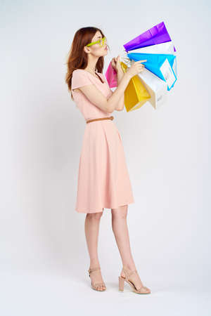 woman holding colorful shopping bags, shopping.