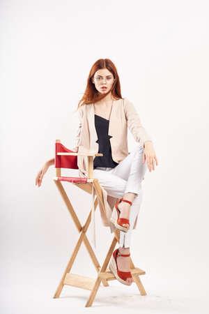 beautiful woman sitting on a high chair, fashion.
