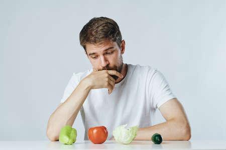 vegetables, diet, man at the table. Standard-Bild