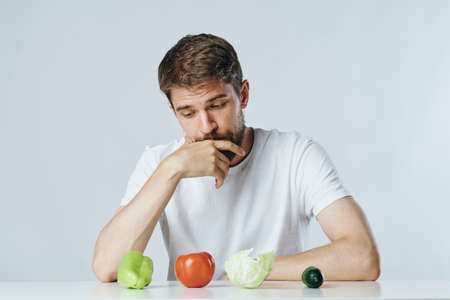 vegetables, diet, man at the table. Stockfoto