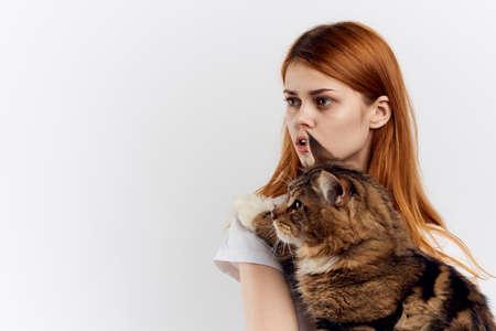 woman holding a cat, portrait.