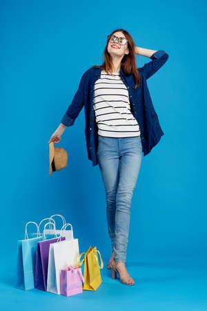 woman shopaholic with glasses. Stock Photo