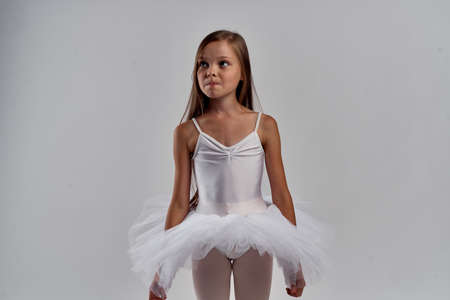 a girl in a white ballet tutu.