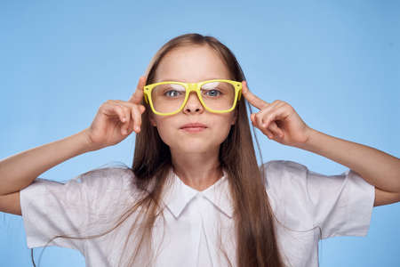 notebook: a little girl with long hair in a white shirt and wearing yellow glasses.