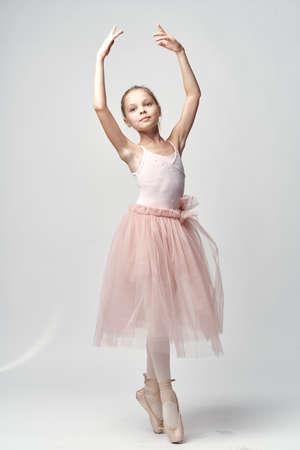 ballerina tights: girl in pink tutu, ballerina on white isolated background.