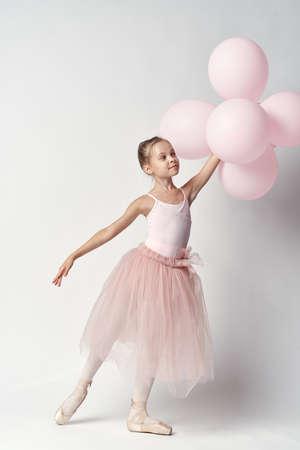kleine ballerina met ballonnen. Stockfoto