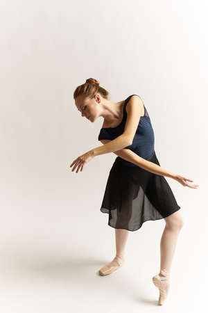 the ballerina bent and crossed her arms. Stock Photo