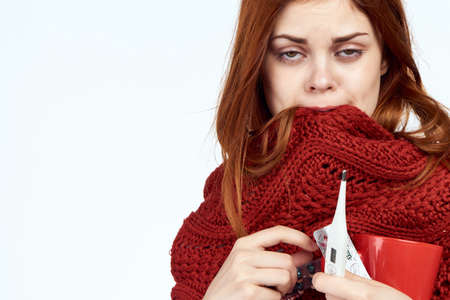 the girl is very sick and bites her scarf.