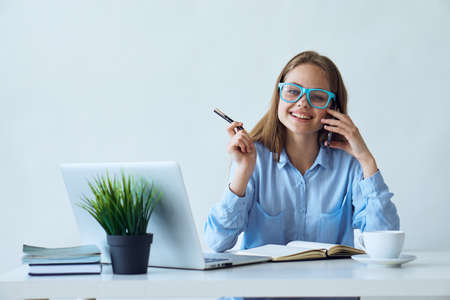 Business woman wearing glasses, business woman talking on the phone, business woman working. Stock Photo