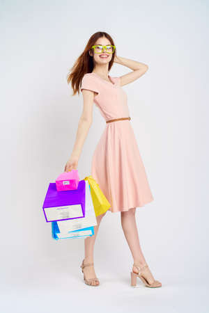 young happy woman on a light background with shopping. Stock Photo
