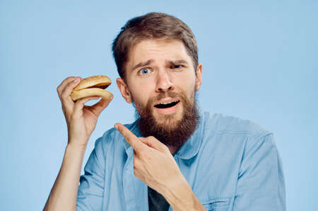 bearded man doubts about the bagels.