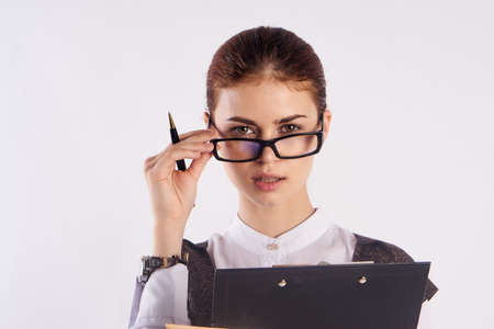 the teacher strictly raised her glasses. Stock Photo