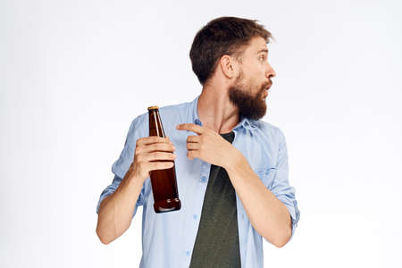 man shows on beer on white isolated background.