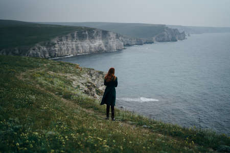 woman, nature, coast, cliff, sea. Stock Photo