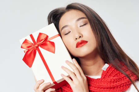 Beautiful woman of Asian appearance gift holiday red