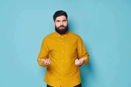 Bearded man in shirt emotion discontent gesturing with hands