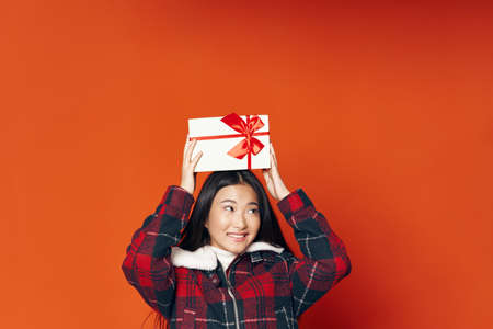 Cheerful woman of Asian appearance winter checkered jacket Archivio Fotografico