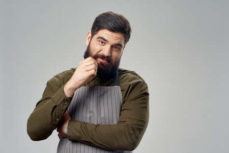 bearded man apron barbershop professional work emotion model 写真素材