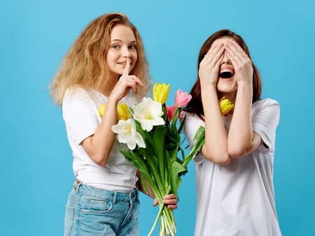 The girl wants to secretly give her mother a bouquet of flowers