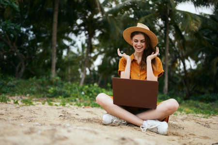 Happy woman on vacation with laptop beautiful model
