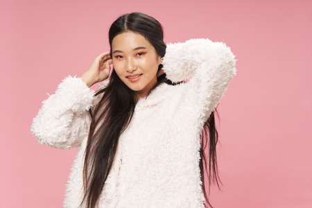 Happy girl of Asian appearance in a sweater Banque d'images