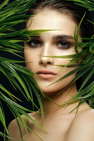 Female face make-up natural look of nature green leaves health