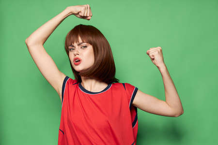 Strong woman clenched her hands into a fist