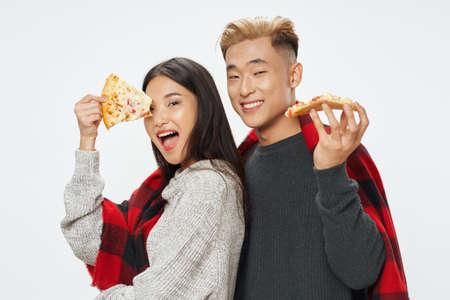 Delicious pizza happy young people warm clothes Archivio Fotografico