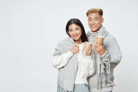 young people married couple warm clothes free space