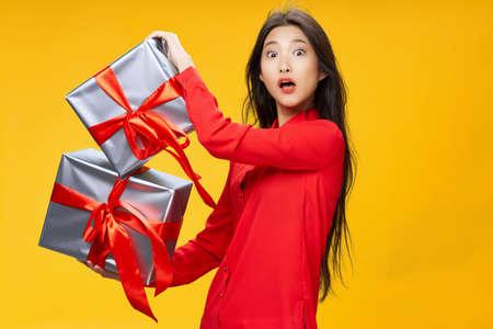 Festive boxes and a surprised Asian girl Archivio Fotografico