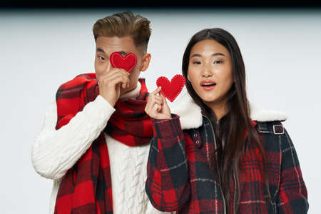 Valentines day married couple warm clothes red hearts Archivio Fotografico