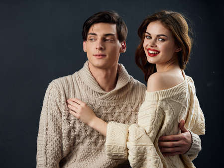 Man and woman sweaters embrace romance dating family portrait Archivio Fotografico