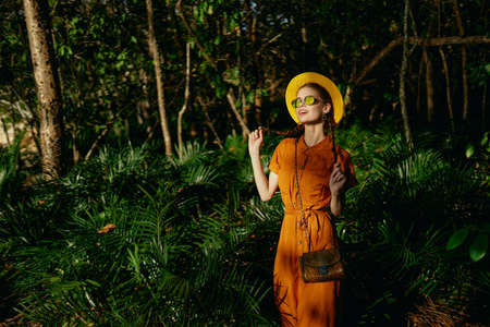 Woman hiker in jungle dense forest green leaves Adventure