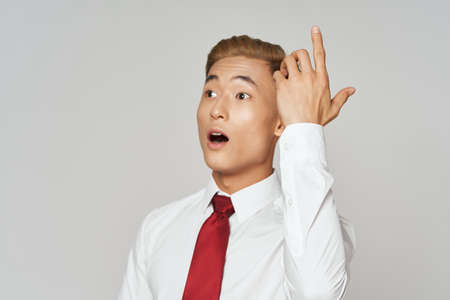 Business man white shirt tie gestures with hands