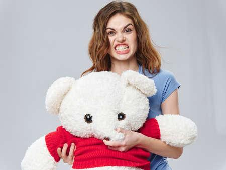 Teddy polar bear in woman hands a gift hug emotional woman