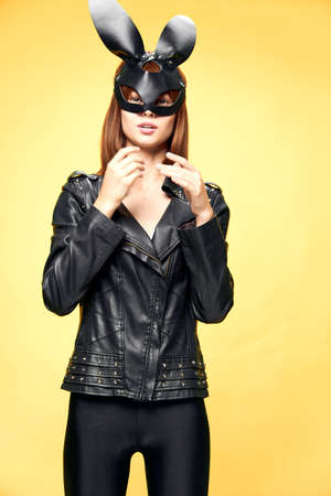 Sexy woman in rabbit mask and black suit, temptation