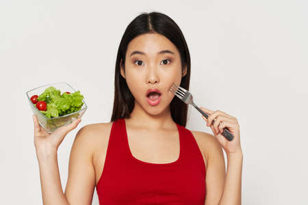Diet food slim figure beautiful woman with a fork in her hand