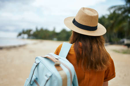travel tourism woman with backpack ocean