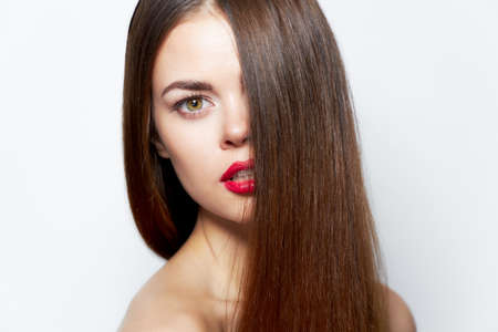 Brunette Attractive look red lips bared shoulders clear skin Stock Photo
