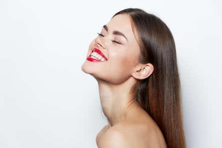 Brunette Naked shoulders red lips smile closed eyes bright makeup Stockfoto