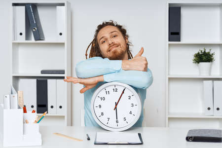 Business man working desk office clock waiting Stock Photo