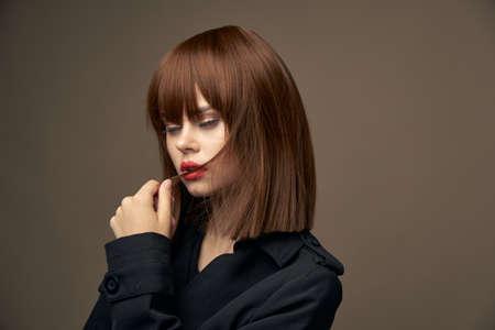 Beautiful brunette Light skin coat beige background